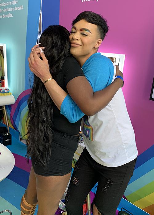 Jose Claudia Hugging at the TurnUpTheLove Salon